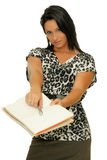 Sign the deal. Business woman offering her pen and book to seal the deal royalty free stock photo