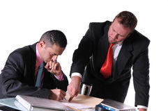 Sign the deal here. Businessman telling his employee where to sign Stock Photo