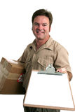 Sign For Delivery. A delivery man bringing a package and holding out a clipboard Stock Images