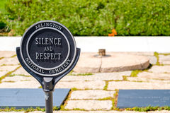 Sign demanding respect next to the Eternal Flame at the Arlington National Cemetery. In Virginia, United States Stock Photo