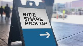Ride Sharing Pickup Location Directional Sign. A sign denotes where the official ride sharing pickup location is outside a large convention center stock video