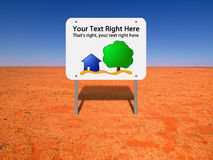 Sign in desolate area. A sign with a house and tree and room for text in the middle of an undeveloped desolate land area Stock Image