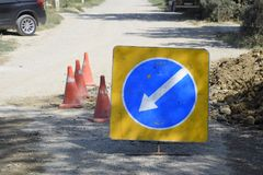 Sign of detour travel. Pit on the road. repair work. Royalty Free Stock Photos