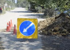 Sign of detour travel. Pit on the road. repair work. Royalty Free Stock Photo