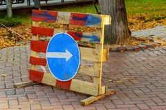 Sign of detour travel. Pit on the road. repair work Royalty Free Stock Photos