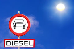 Sign Diesel cars prohibited against blue sky and sun. Stock Images