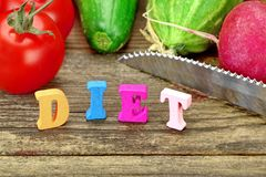 Sign Diet Made From Wood Letters And Fresh Local Vegetables Royalty Free Stock Photo