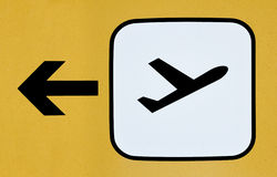 Sign for the direction of the departure terminal at an airport. Sign with an airplane taking off for the direction of the departure terminal at an airport Stock Photo