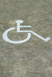Sign disabled or handicapped, detail of a signal in a parking Royalty Free Stock Image