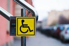 The sign for the disabled on the handrail.  royalty free stock photos