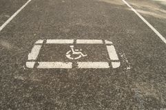 Sign disabled Parking on the pavement of an empty Parking lot Royalty Free Stock Photo