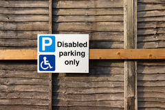 Sign: Disabled Parking Only. On Wood Wall background royalty free stock photography