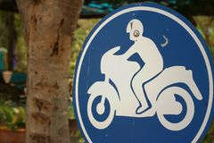 Sign displaying the international symbol for a motorcycle Stock Image