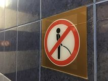 Sign ` do not urination`. A badge of on the wall `urination prohibited from Stock Photo