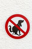 Sign dog feces prohibited. On a white wall Royalty Free Stock Photo