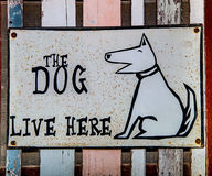 Sign dog live here Royalty Free Stock Photo