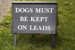 Sign for dog owners to keep dogs on leads Stock Photography
