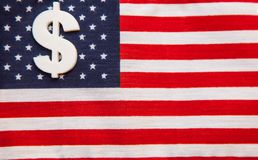Sign of dollar  currency on american flag background Royalty Free Stock Photos