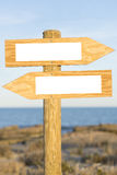 Sign. A double direction wooden sign stock images