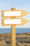 Sign. Double wooden direction sign stock images