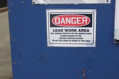 Lead Poisoning. A sign in downtown Manhattan, warning about lead work being done and the possible harmful effects it might have on the health of people royalty free stock photo