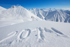 2014 sign drawn at snow Stock Photography
