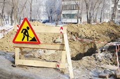 Sign Earthworks at dug trench with fence tape. Stock Photography