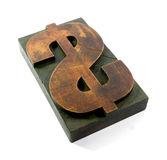 Sign of the Economy. A large wooden printing block with the dollar symbol royalty free stock images