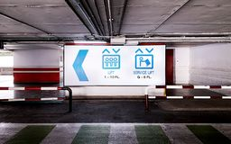 The sign of elevator in the underground parking lot. The blue sign of elevator in the underground parking lot royalty free stock photography
