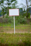 Sign. Empty signboard on a green field Royalty Free Stock Photos