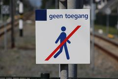 Sign on the end of the railroad station platform of Boskoop with dutch text Geen Toegang which means no entry to prevent people wa. Lking on the track royalty free stock image