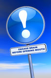 Sign - Engage Brain Before Opening Mouth. Exclamation point sign against the cloudy sky Stock Photos
