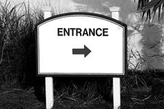 Sign entrance middle direction of entry on the left  side white blue red total white black white Stock Images