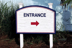 Sign entrance middle direction of entry on the left  side white blue red total white Royalty Free Stock Photo