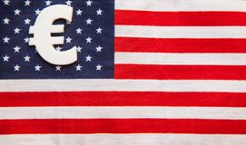 Sign of euro  currency on american flag background Stock Images