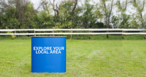 Sign Explore your local area on a blue background Stock Images