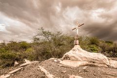 A sign of faith, a cross, beautiful clouds in a dry land at Cari. A sign of faith, a cross, beautiful clouds in a dry land Royalty Free Stock Photo