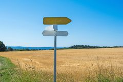 sign and farmland, mountain backdrop and beautiful sky stock image