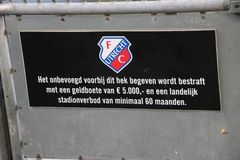 Sign in the FC Utrecht stadium that entering this fence and entering playfield. Will punished with 5000 euro and at least 60 months stadium ban royalty free stock photo
