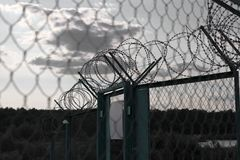 Sign on a fence with barbed wire.  Royalty Free Stock Photos