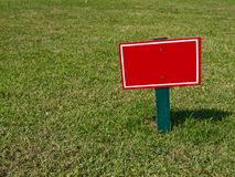 Sign on field Stock Photos