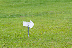 Sign on field grass Royalty Free Stock Image