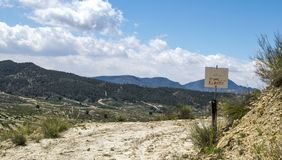 Sign in a field saying Private property. Keep out royalty free stock images