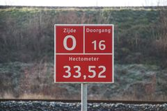 Sign for firefighters, paramedics and police where and which entrance it is to busy railroad track at Zwijndrecht. stock photos