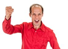 Exited young man kicks air clenched fists arm Royalty Free Stock Image