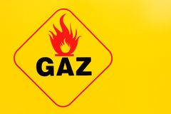 Sign flammable and gas. Yellow background Royalty Free Stock Image