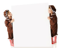 Sign Flanked by Gingerbread Girls Royalty Free Stock Images