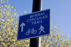 Sign for footpath and cycle path for the Wirral Circular Trail Birkenhead Wirral April 2019. Blue sign for footpath and cycle path for the Wirral Circular Trail royalty free stock photography