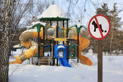 Sign forbidding dog walking on children's sports playground. Stock Photography