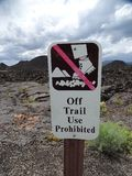 A sign forbidding hiking off the trail royalty free stock photos